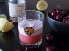 A simple gin fizz made with cherry gin, muddled cherries, lime juice, and a deliciously frothy egg white.