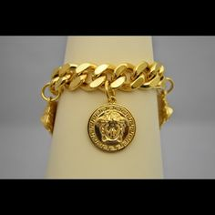 """Iced Out 24K Gold Plated 3 Medusa Head Bracelet Attn: Hip Hop, Ent Artist, Men's Jewelry, DJ, Rapper, Producer. This bracelet is one of the best gifts to buy for a friend! It is made of gold-plated stainless steel and excellent quality! Stainless steel is a durable metal that is resistant to corrosion. Shines great, looks great! All bracelets are brand new and come in new packaging. Brand: Unbranded. Length: 8.3"""". Width: 19mm. Weight: 165 Grams. Diameter of Circle Pendant: 1.18"""". Size of…"""