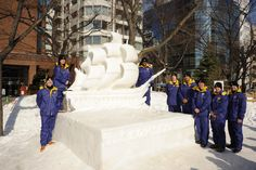 SAPPORO, Japan (Feb. 2, 2015) The 2015 Navy Misawa Snow Team pose with the USS Constitution snow sculpture during the 66th annual Sapporo Snow Festival. The team created the sculpture for the festival and as a tribute to the U.S. Navy's oldest commissioned ship. This is the 32nd year that Naval Air Facility Misawa and its tenant commands have sent a delegation of Sailors to the festival to create a sculpture, and to serve as goodwill ambassadors. (USN Senior Chief Mass Comm Spec Ryan…