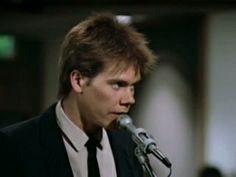 http://content.internetvideoarchive.com/content/photos/7464/16393246.jpg Ren (Kevin Bacon) makes the case for the ban against music and dancing at the council meeting in Footloose (1984).