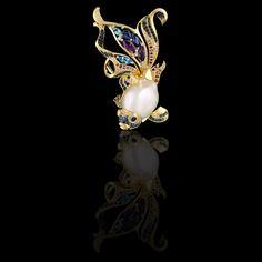 Brooch/pendant of 18K yellow and white gold, baroque pearl, diamonds, blue diamonds, purple diamonds, blue sapphires, topazes, amethysts.