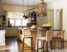 Designer Barry Dixon hung an Asian fish trap lantern for this kitchen's owner, who spent her childhood in Asia.   - HouseBeautiful.com