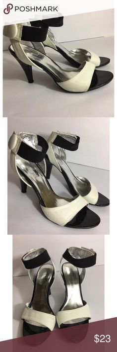 Coach And Four Ankle Heels Size 7.5 Med Career Coach and Four Ankle heels, size 7.5. Black/White. Excellent shape. Coach & Four Shoes Heels