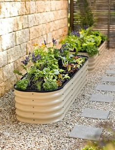 "This modern take on a watering trough makes an interesting raised bed, and can be built in one of four different configurations: a 5' 5 1/2"" x 3' 3"" rectangle, a 4' 9"" x 3' 11"" rectangle, 6' 10 1/2"" x 1' 9 1/2"" rectangle, or a 3' 3"" x 3' 3"" square. From gardeners.com."
