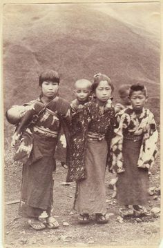 1880's Japanese photograph of young Japanese girls carrying babies on their backs.