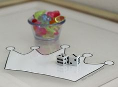 A fun way to combine learning and fairy tales on the light table! This simple crown jewels math game for preschoolers is great for any princess lover!