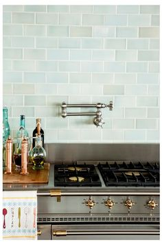 greyish turquoise tiles...love for the backsplash!  Adds color to the space!!!