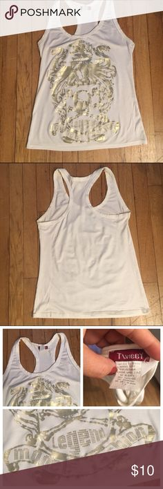 White stretchy tank top with gold graphic -size L Fun white tank top with gold graphic motif on the front. Super fun and cute. Can be dressed up or down. Size Large but more like a juniors Large (women's Medium). twiggy Tops Tank Tops