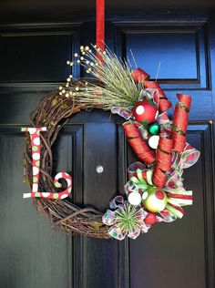 Not crazy about all the decorations on this wreath, but like the arrangement. Add bells