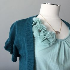🎈HP🎈{Tulle} Flutter Ruffled Sleeve Cardigan Teal short sleeve cardigan with ruffled sleeves & buttons at front. 65% Acrylic, 35% Cotton. Tulle Sweaters Cardigans