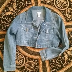 LISTING Crop Jean jacket Super cute with a nice skirt, pants or jeans. Comes down just below the chest . NWOT it's just been hanging in my closet because I know I'll want it when it's gone but I don't wear it Body Central Jackets & Coats Jean Jackets