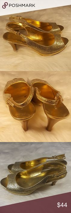 """Nine West pumps slingback gold heels women's 9.5 Nine West gold slip on peep toe heels pumps size 9.5 adjustable back straps Gold shoes . Thanks so much for checking out my listing . 4.5"""" heels    Shipping , I ship out Monday - Saturday Nine West Shoes Heels"""