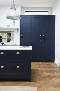 Herringbone wood floors with navy kitchen cabinets, marble counters and gold hardware for an old meets new kitchen design. New Kitchen Cabinets, Kitchen Doors, Home Decor Kitchen, Kitchen Flooring, Home Kitchens, Kitchen Ideas, Kitchen Units, Navy Kitchen, Parquet Flooring