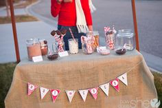 Hot Chocolate Stand with FREE Printables! A great opportunity to raise some money and teach your family about giving by sharing the earnings with those in need! | HowDoesShe.com