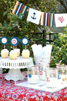 Use cocktail napkins to make an inexpensive party banner! Love this Nautical Party from A Thoughtful Place!