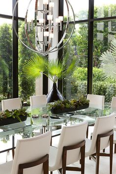 I like the glass top table, light fixture, and those chairs look really comfortable. Designed by SLC Interiors