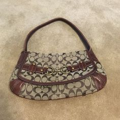 Authentic Coach Purse Authentic Mid sized Coach Purse! Has a zipper pocket and two smaller open pockets inside! Coach Bags Shoulder Bags