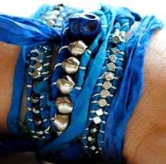 Beautiful sari silk bracelet-I seriously need to make myself some of these. It's not like I have a shortage of sari silk ribbon or anything!!!