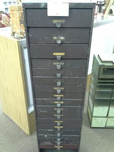 SOLD - Many possible uses for this vintage metal cabinet with 17 drawers. The cabinet measures 12 inches by 10 inches and stands 41 inches tall. It can be seen in Booth B13 at Main Street Antique Mall 7260 East Main St ( E of Power Rd ) Mesa 85207  480 9241122open 7 days 10 till 530 Cash or charge 30 day layaway also available