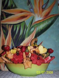 Edible Creations How to: Fruit Centerpiece. This is a great site to learn about centerpieces, bouquets, and other edible crafts!