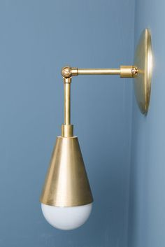 This wall sconce with cone is made with all brass and can be adjusted 180…