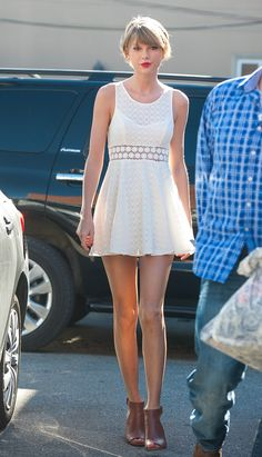 We love how Taylor pairs her summer-y dress with brown booties and a red lip, making it totally her own.   - Seventeen.com