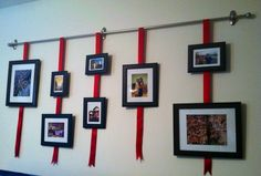 Gallery wall hanging I did using Command Hooks, a curtain rod, and picture frames stapled to ribbon. No nail holes!