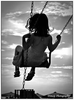 Swinging on the playground across the street from St. Michael's and swinging as high I we could then jumping off on the highest point to run back to class... oh the memories!