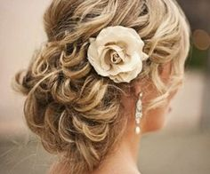 very elegant- makes me want to grow my hair back out just for this. Thanks Em!