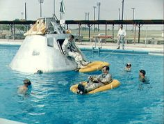 The Apollo spacecraft were designed to return to Earth by landing in the ocean, which meant extensive water egress training for the astronauts. This involved practicing with model spacecraft in pools and the Gulf of Mexico. Above, the crew of Apollo 1 practices in a swimming pool in 1966. Astronaut Edward white is in the life raft in the front of the image, astronaut Roger Chaffee sits in the hatch and astronaut Virgil Grissom is inside the spacecraft.