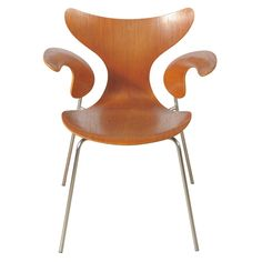 """Arne Jacobsen armchair """"The Lily,"""" chrome and moulded laminate teak, Denmark, 1970"""