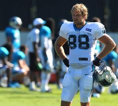 Carolina Panthers tight end Greg Olsen watches as teammates run through a drill during practice on Monday, August 31, 2015.