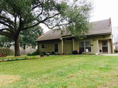 Superbly updated home on the Teche with a guest house! On the inside you are sure to fall in love with the open floor plan, built in breakfast bar, Jenn-Air gas range, granite counter tops, new tile, hand-scraped wood floors, solid wood raised panel doors, completely renovated master bath, large office or playroom upstairs, nice sized rooms, tons of storage & lots of charm make this home stand out above the rest. On the outside you will surely adore living on the Teche with fruit & cypress…