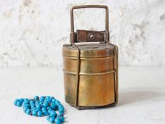 This beautiful example of a large sized Tiffin is configured in three-tiers and opened by unlocking a small catch. Best Gifts, Unique Gifts, Money Jars, Vintage Lunch Boxes, Jewellery Boxes, Large Homes, Tin, Brass, Indian