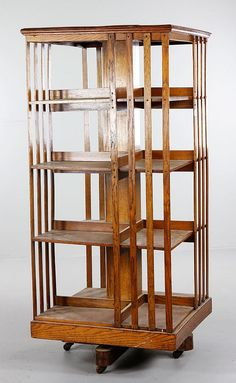 Realized Price: $400 Estimated Price: $300 - $500 Oak Arts and Crafts revolving bookcase, 50'' h x 22 1/2 square. Provenance: Estate of Alexander Brook