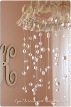 DIY: Crystal Mobile. Pretty for even a big girls room.