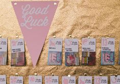 The escort cards are lottery scratch off tickets! | gold and pennant escort card board
