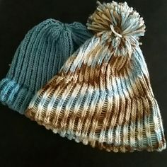 **HUGE SALE**Handmade (by me) beanies Blue with spots of rainbow colors, brand new made by me. I can do other colors also.  This listing you get both hats, the one with the ball on top, the ball is a little loose (first one I made). Accessories Hats