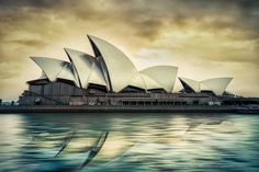 Photographer: ©Jacob Surland.  The Sydney Opera House is the most photographed construction on the southern hemisphere. As a Danish photographer and Artist, it makes me proud, to know that a Danish architect made it. It is one of the most well known buildings in all of the World. This is my steampunk version of a classic shot. Photo by: Jacob Surland, www.caughtinpixels.com.  (=)