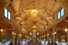 This is a unique venue for a wedding. The wooden barn like structure is rustic, but elegant at the same time. The chandeliers and vaulted ceilings probably add to the elegance. The fact that there's so much room to move around also appeals to me.