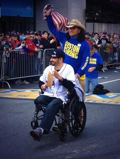Carlos Arrendondo pushing a Marathon Bombing victim over the Finish Line. Red Sox World Series Champs Rolling Rally (Duck Boat Parade) 11/2/2013