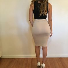 Nude Midi Pencil Skirt Beautiful Nude Bodycon Midi skirt. Brand new. Never worn. No flaws. 87% polyester, 13% spandex. Available in S-M-L. Model is wearing a small for reference. Bundle for 10% off. No Paypal. No trades. No offers will be considered unless you use the make me an offer feature.     Please follow  Instagram: BossyJoc3y  Blog: www.bossyjocey.com Skirts Midi