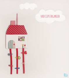Oh this is too cute! A little house to keep hair clips in one place. Adorable...