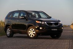Black Kia Sorento - What I will most likely be driving with the kids in the future....