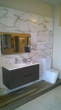 We are very pleased to show you this #bathroom made by our customer #AzulejosClover with our #ceramics! They used: RECTIFICADO 9518 NATURAL, RECTIFICADO 9518 NATURAL RELIEVE and 1327 series on the floor.