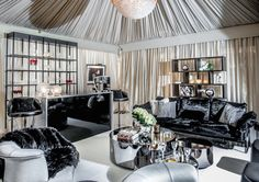 In her glamorous room for the 2015 Holiday House NYC designer showcase, designer Ally Coulter surrounded the space with luxury by creating a tent from lustrous draped fabric. Nyc Holidays, Crystal Chandelier Lighting, Upper East Side, Outdoor Rooms, Fabric Decor, Living Spaces, Living Room, Architecture Design, House Design