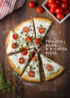 Tomato Basil & Ricotta Pizza - Combining yogurt and ricotta with some sautéd onions and garlic, makes the perfect base, while adding some chopped basil, cherry tomatoes and thyme makes rounds out this beauty. It's unique flavor combination will definitely have you making it again!