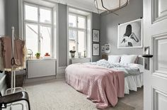 Stunning soft pinks and greys teamed with timber transform this bedroom into a dreamy oasis where one can escape.