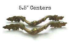 Pair of vintage ornate drawer pulls with all 4 screws -Great, original brass patina, one is slightly lighter/bright than the other -Very unusual French Provincial style in this size, amazing qualtiy (solid brass) -These measure: Just over 7.75 wide, 1 1/4 tall, 5.5 center to center hole spacing VERY RARE SIZE   See more ornate and French Provincial Drawer Pulls here: https://www.etsy.com/shop/Fairyhome?section_id=8156245&ref=shopsection_leftnav_1  Send me a message if you have any questions…