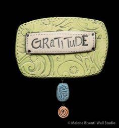 Gratitude ceramic wall plaque.    © Malena Bisanti-Wall.  www.mbwstudio.com
